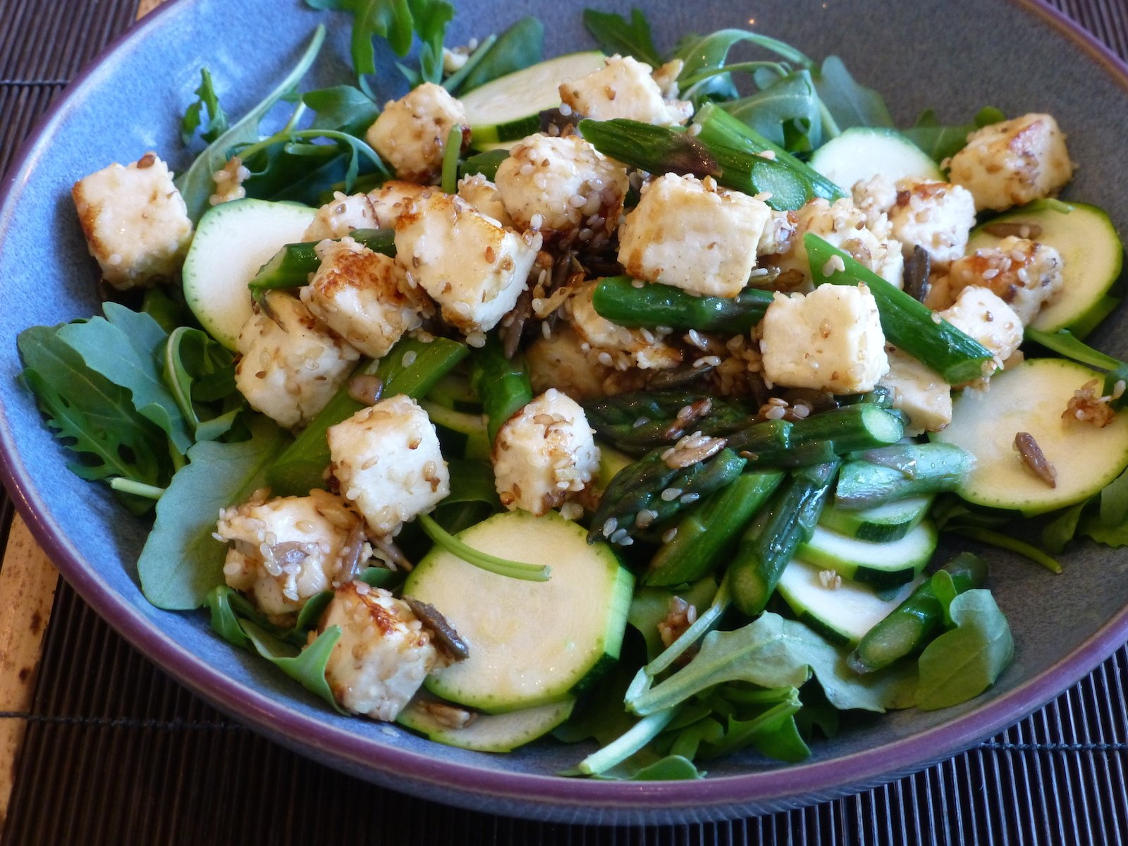 Asparagus and paneer on a bed of rocket and courgettes