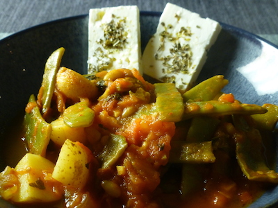 Greek-style green beans in tomato sauce with feta and rice