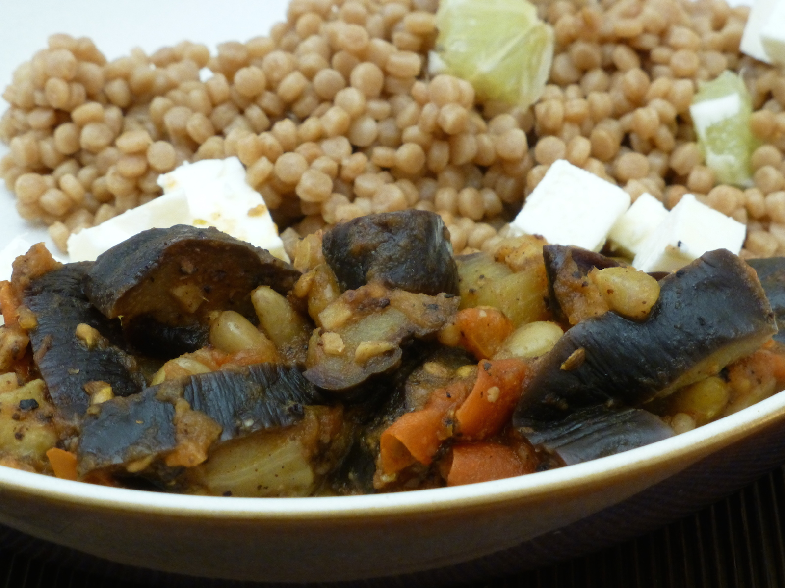 Imam bayildi with couscous and feta