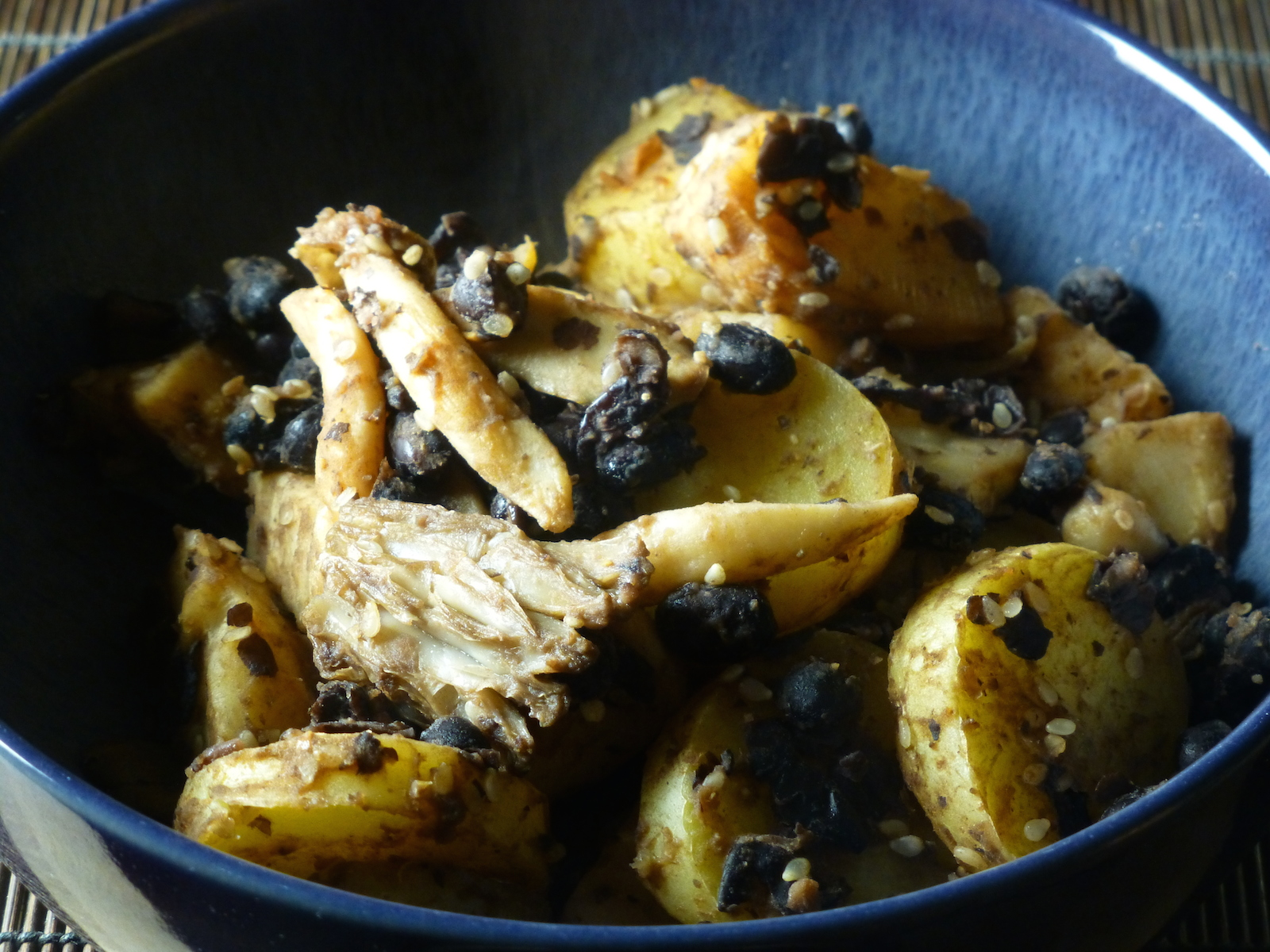 Stir-fry of mixed mushrooms with black beans, celeriac and potatoes