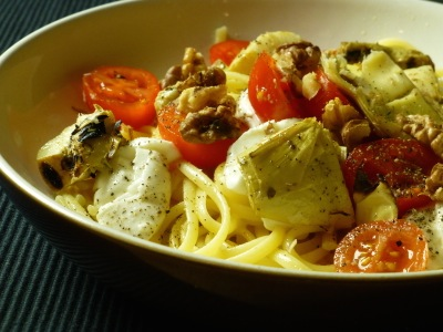 Pasta with mozarella, tomatoes and antipasti
