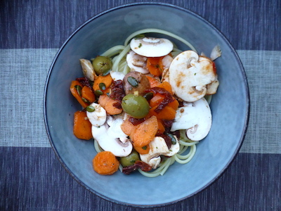 Cold pasta with raw carrots and mushrooms