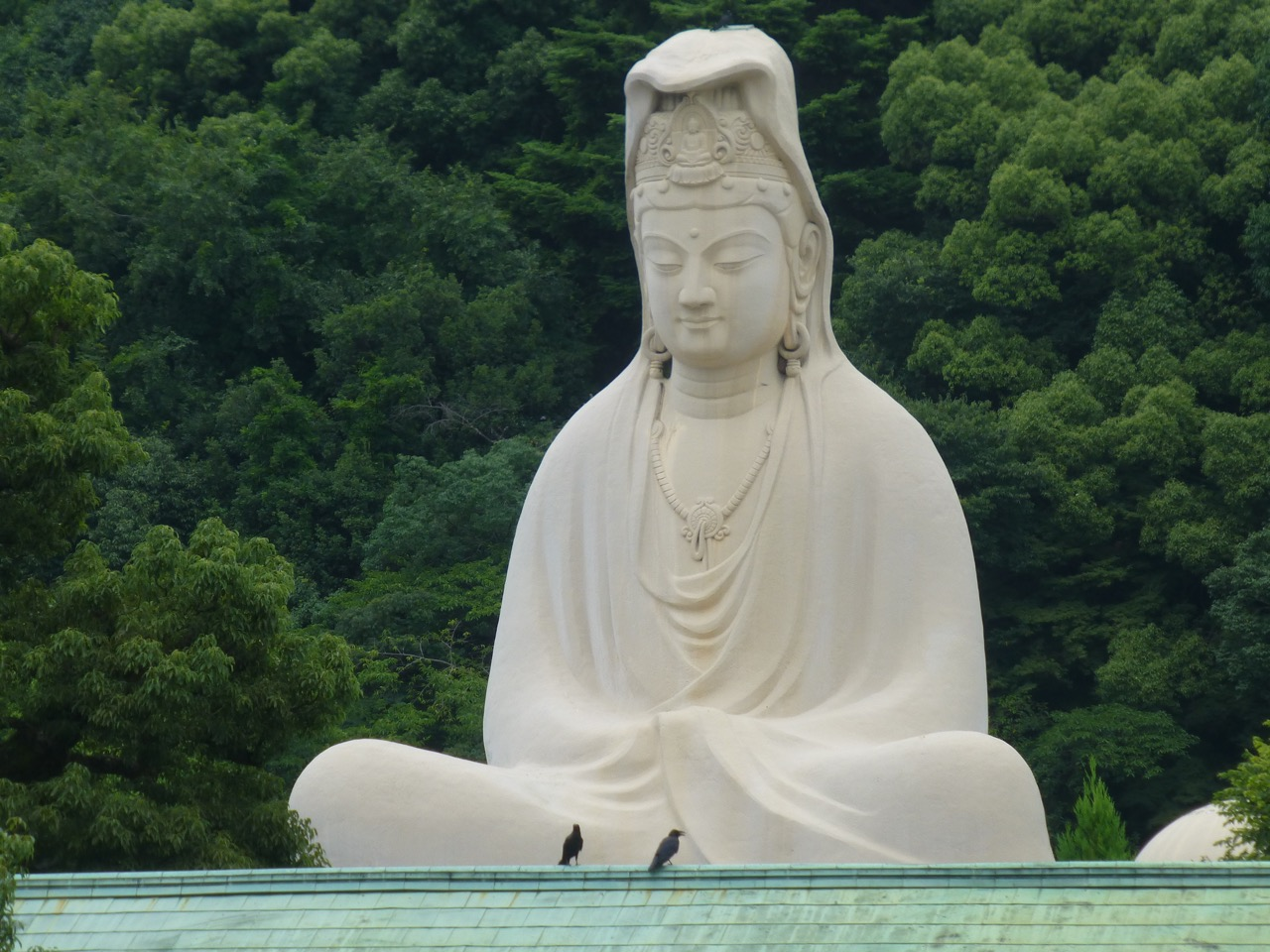 A white statue of a seated kannon.