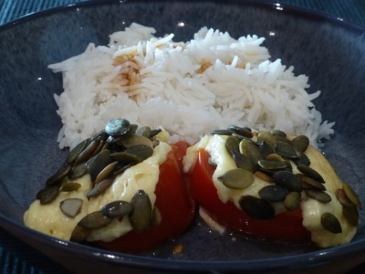 Tomatoes with halloumi and pumpkin seeds, served with basmati rice