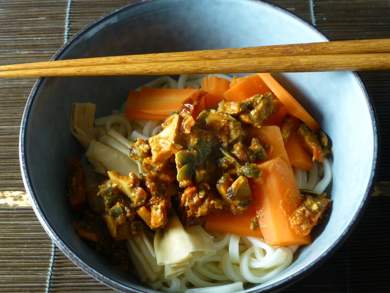 Udon with carrots and tofu skin knots in a mildly spicy sauce